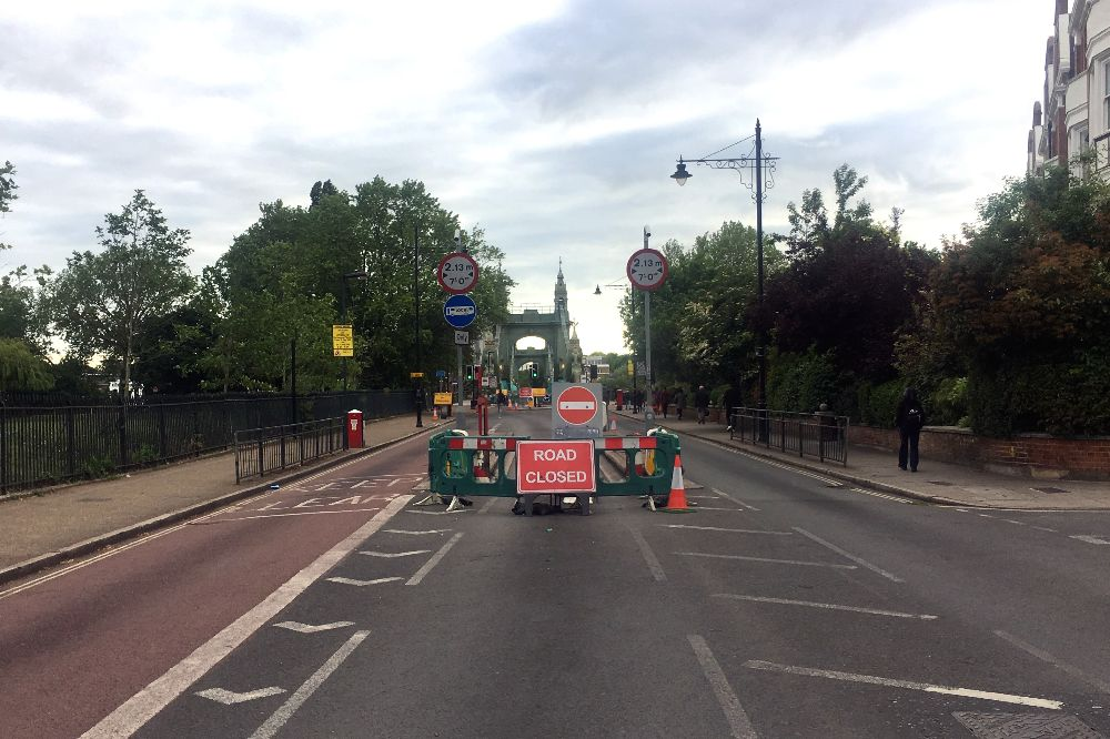Excessive signage on the approach to Hammersmith Bridge