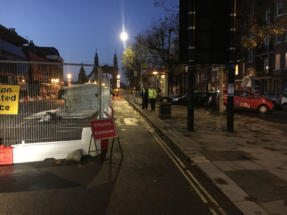 """""""Cyclists Dismount"""" signs and stewards at Hammersmith Bridge"""